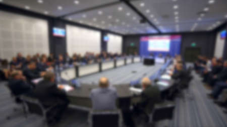 Speaker political congress discusses problems. Dialogue round table international nations. Politician talk speech in mic. Adult speaker negotiator with members summit. Politic crowd audience talking.