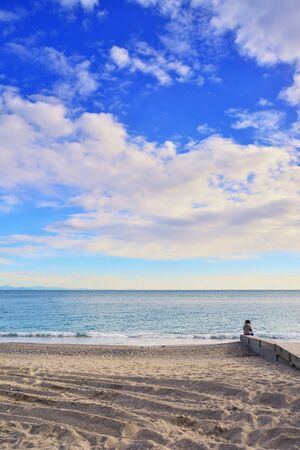 Noli, Imperia, Liguria, Italy. The beach of Noli, a seaside village in the province of Imperia, on a clear winter day.