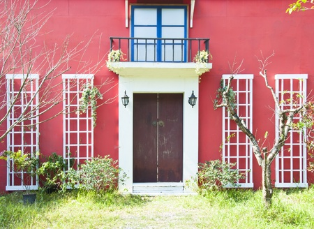 red wall brown door white glass windows photo