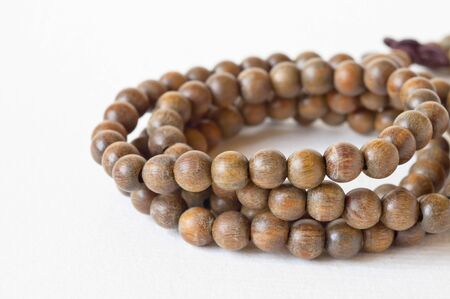 one item: one Item brown prayer beads on white background