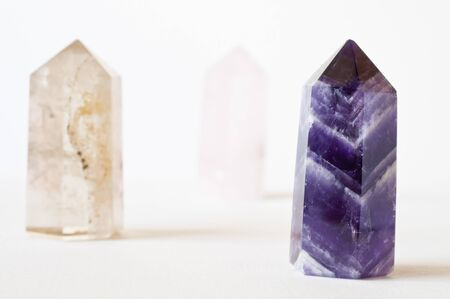 purple yellow crystal upright in white background