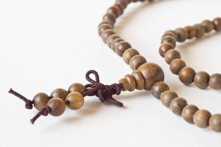 one item: one Item brown prayer beads and white background Stock Photo