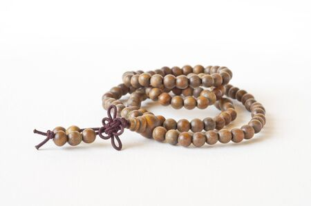 one item: one Item brown prayer beads closeup on white background Stock Photo