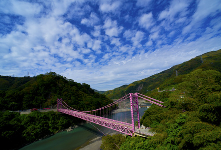 superstructure: Blue sky and white clouds in the valley purple bridge