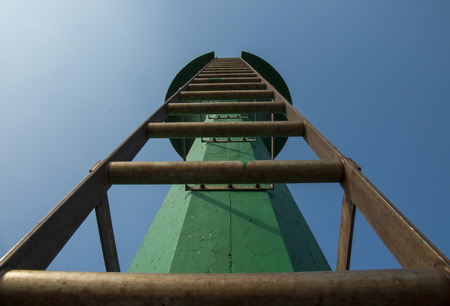 up stair: Construction of tower against blue sky