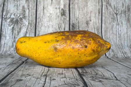 overripe: Wood background with overripe papaya Stock Photo