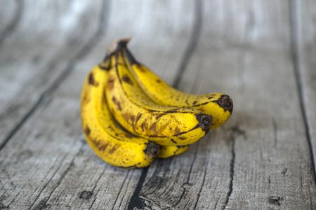 overripe: Wood background with overripe bananas