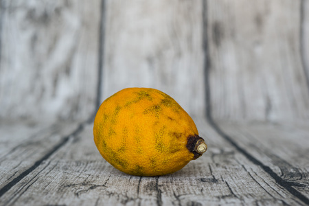 rotten yellow lemon put on wooden table