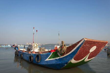 Colorful fishing boats under blue sky