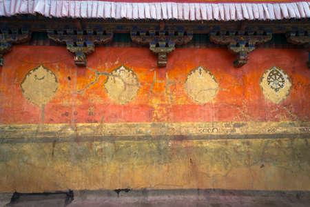 Ornate eaves and orange stone walls