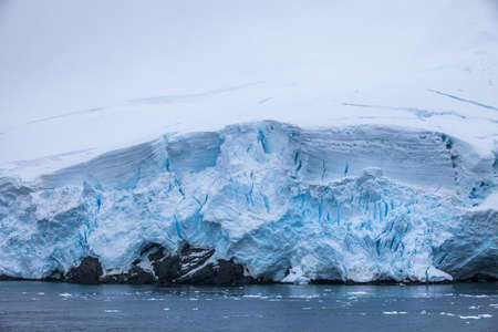ice floe: Small part of the blue larger iceberg in water ocean of the Antarctica landscape