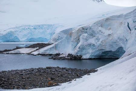 Landscape of the coast on ice-covered mountainous island off the coast of Antarctica. Stock Photo