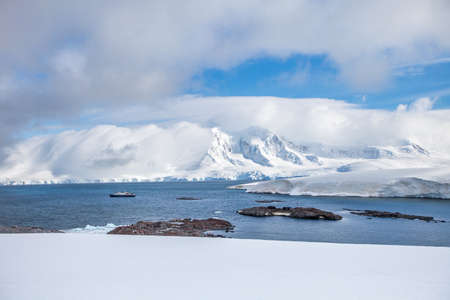 Coast of Antarctica with centuries-old thicknesses of glaciers and icebergs of unusual forms.
