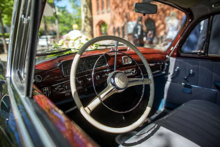 Steering wheel of retro car and dashboard