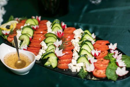 Slices of tomatoes and cucumbers.