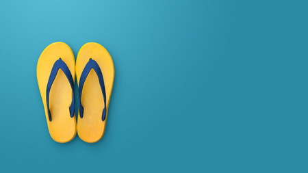 flip flops: Flip flops isolated on blue background. Top view and copy space. Slippers yellow Stock Photo