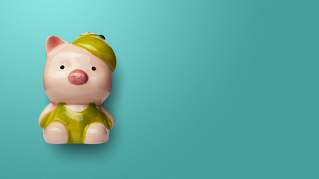 Piggy bank isolated on green background. Investment and saving concept Imagens
