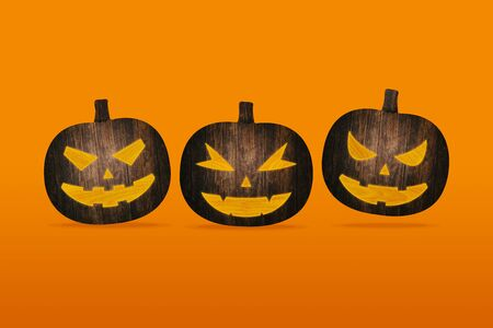 Pumpkins Made From Wood On Orange Brick Wall Top View