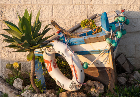 prow: Prow of an old fishing boat reused as a embellishment by the wall of a house Stock Photo
