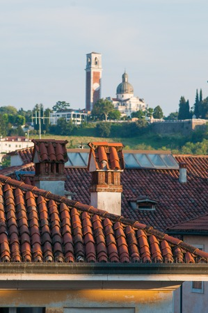View of typical roofs of some houses in Vicenza with Mount Berico in the background
