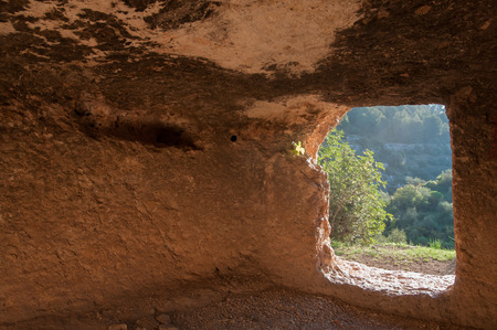 Inside view of a rock-cut tomb in the necropolis of Pantalica in southeast Sicily