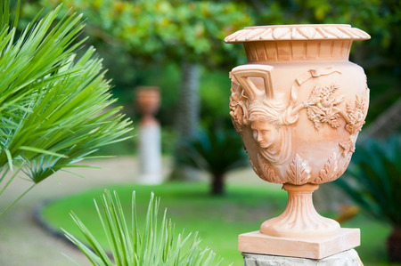 Close-up view of a terracotta vase and its handmade decoration in the public gardens of Caltagirone photo