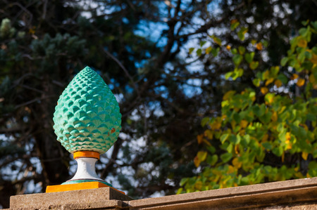 cone shaped: Close-up view of a typical colored pine cone shaped piece of ceramics used as an ornament in the main public gardens of Caltagirone