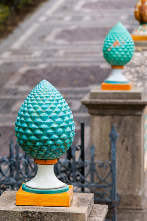 Typical pine cone shaped piece of colored ceramic from Caltagirone used as a ornament on the entrance gate of the main public gardens of the town