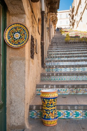 View of a colored ceramic plate and a vase from Caltagirone in its famous staircase