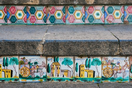 folkloristic: Close-up view of some steps of Caltagirone staircase with colored ceramic tiles portraying the characteristic sicilian cart Stock Photo
