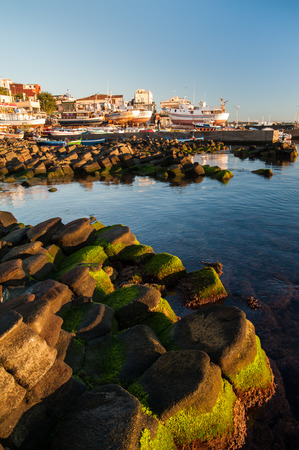 characteristic: The town Acitrezza, in the east coast of Sicily and its characteristic basalt rocks by the sea Stock Photo