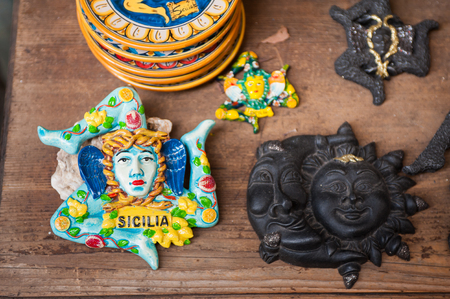 folkloristic: Close up view of some typical sicilian ceramic souvenirs in a street of Castelmola