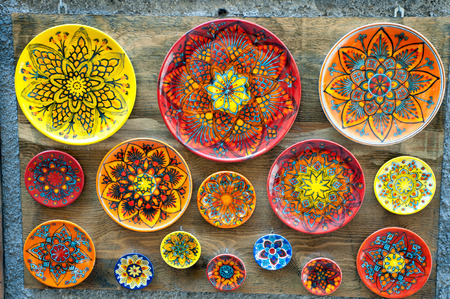 folkloristic: Group of ceramic plates, souvenirs along the streets of Castelmola