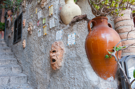 Perspective of a very folklorist wall in Castelmola, Sicily, with different kinds of pottery photo