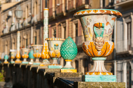 Close up view of one typical ceramic vase from Caltagirone with its motis and designs, used as an ornament along the wall of the main public gardens of the town