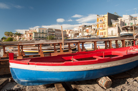 folkloristic: Fishing boats in a dock of the town Acitrezza, a tourist fishing village in Eastsicly