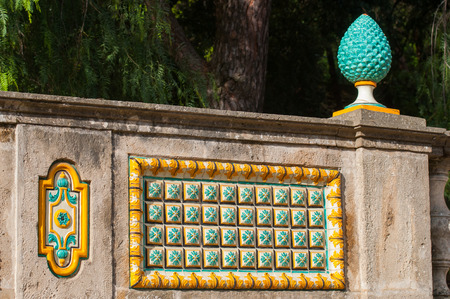 Typical colored tiles from Caltagirone used as an ornament along the wall of the public gardens