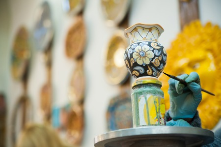 View of a ceramic pot from Caltagirone being decorated by a local artisan
