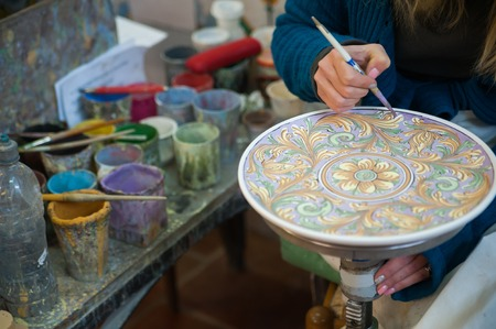 View of a ceramic pot from Caltagirone being decorated by a local artisan Фото со стока - 37699749