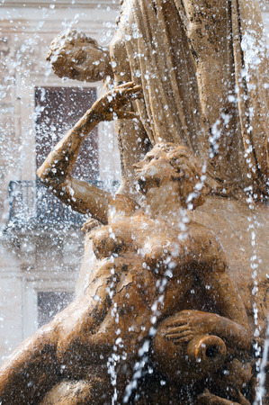 gush: Perspective of some architectural elements of the Fountain of Diana in Syracuse, a work by the sculptor Giulio Moschetti, in 1907 Stock Photo