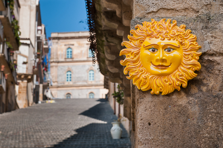 folkloristic: Perspective of the famous Caltagirone staircase with a typical folkloristic ceramic souvenir of the sun on the foreground