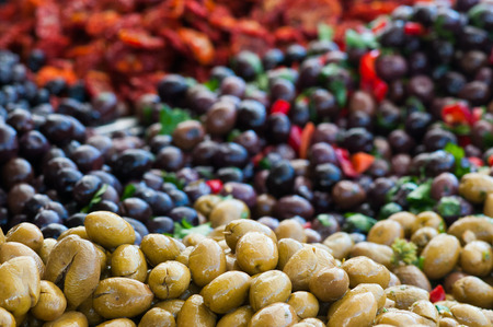 pimiento: View of green and black olives in a sicilian weekly market Stock Photo