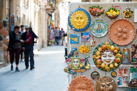Detailed view of some typical and coloured souvenirs of Sicily along the streets of the town Stok Fotoğraf - 38817814