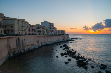 syracuse: Eastern side of old Syracuse with rock and sea at dawn