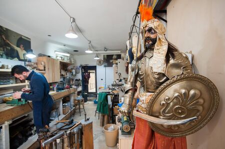 brassy: Sicilian puppets of a saracen soldier with His armor in the workshop of a puppet artisan in Syracuse
