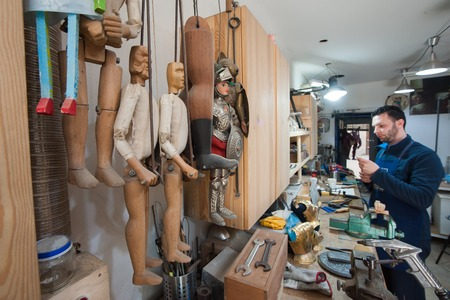 View of some unfinished Sicilian marionettes in the studio of a puppet artisan in Syracuse