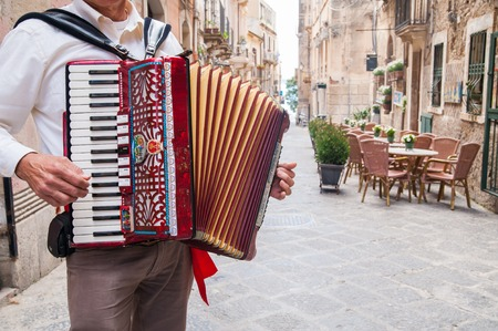 Accordion musician playing along the alleys of the old part of Syracuse Ortigia Stok Fotoğraf - 40211687