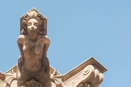 historical periods: Ornamental sculpture of a mermaid on the roof of a Baroque palace in Lentini, Sicily