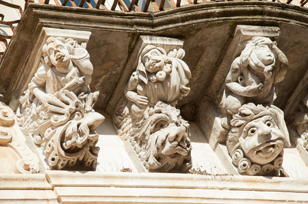 grotesque: View of some typical baroque mascarons under the balconies of Cosentini Palace in Ragusa Ibla, Sicily