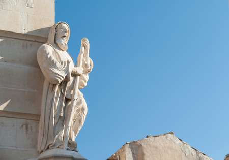ragusa: The baroque statue of St. Francis of Paola sculpted at the corner of Cosentini palace in Ragusa Ibla
